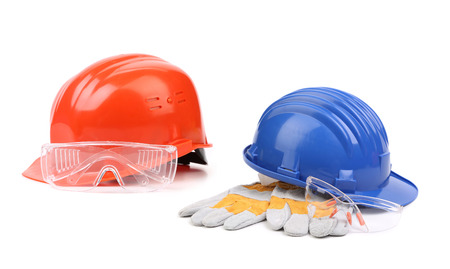 Two hard hats with working yellow gloves photo
