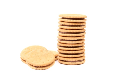Stack of cookie biscuits with filling. Close up photo