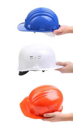 White red and blue hard hats isolated on white photo