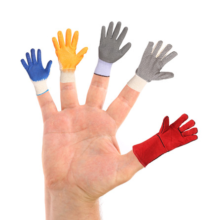 Five different small gloves wearing the fingers from a hand photo