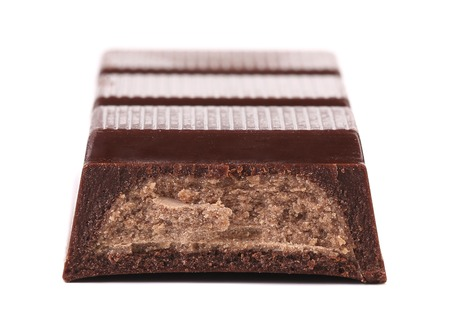 Bar of chocolate with a filling. Macro. Isolated. On a white background photo
