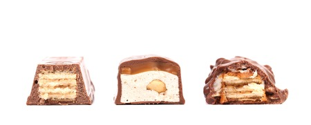 Different slices bar of chocolate. Close up. Isolated. On a white background Stock Photo - 23498311