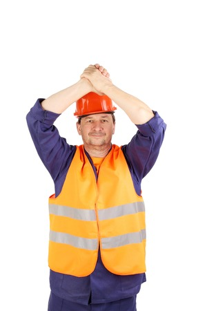 Worker raised hands over the head. Isolated on a white backgropund. photo