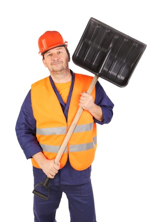 Worker in hard hat holding shovel. Isolated on a white backgropund. photo
