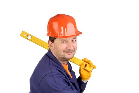 Worker in hard hat holding ruler. Isolated on a white backgropund. photo
