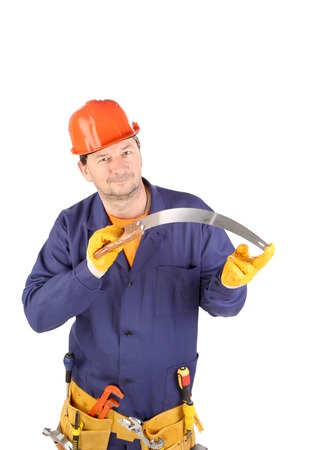 Worker in hard hat holding saw. Isolated on a white backgropund. photo