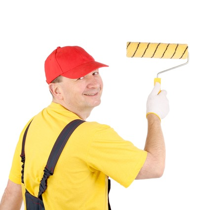Worker working with roller. Isolated on a white backgropund. Stock Photo - 23498426