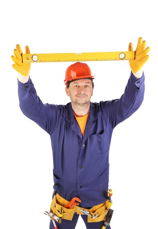 Worker in hard hat raising ruler. Isolated on a white backgropund. photo