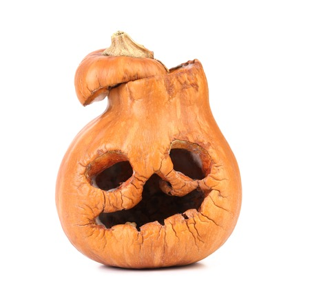 Closeup of old scary pumpkin jack. Isolated on a white background.