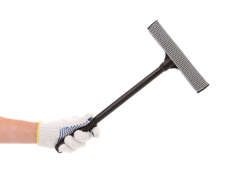 Hand in gloves with rubber window cleaner. Isolated on a white backgropund. photo