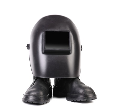 Welding mask and pair boots. Isolated on a white background. photo