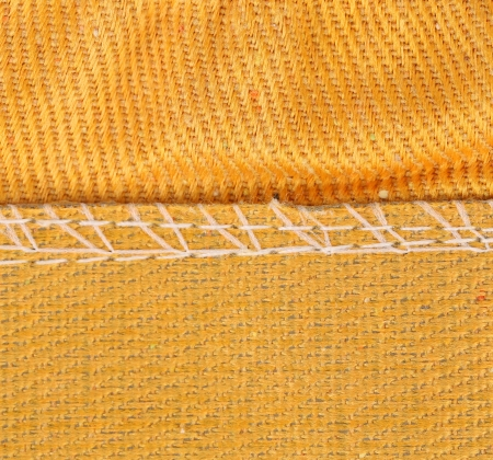 Texture of cloth with stitch. Whole background.