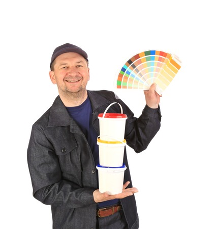 Man with color samples for paint. Isolated on a white background. photo