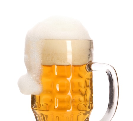 Christmas hat as foam in big mug of beer. Isolated on a white background. Stock Photo - 23533378