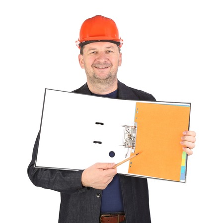 Worker in hard hat with opened folder. Isolated on a white background. photo