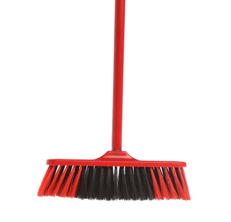 Close up of red black broom. Isolated on a white background. photo