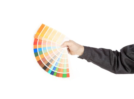 Man hand holding color samples. Isolated on a white background. photo