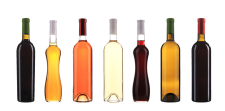 Collection of wine bottles in row. Isolated on a white background. photo