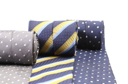 Rolled up three mans ties. Whole background. photo