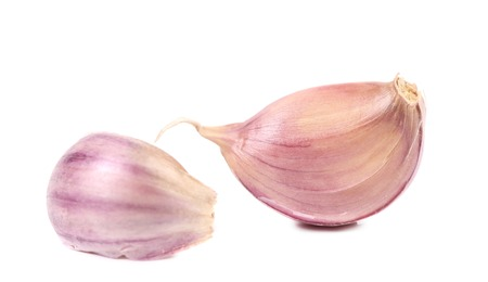 Red garlic cloves. Isolated on a white background. photo