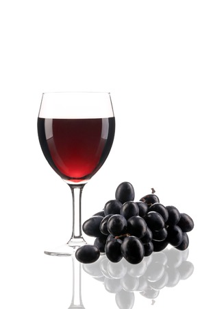 Composition of grapes and red wine. Isolated on a white background. photo