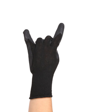 thoroughly: Gloved hand giving the Rock and Roll sign. Isolated on a white background. Stock Photo
