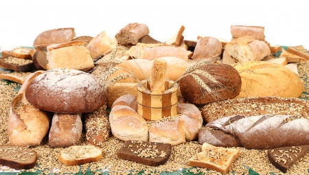 Composition of breads and wheat. On a white background photo