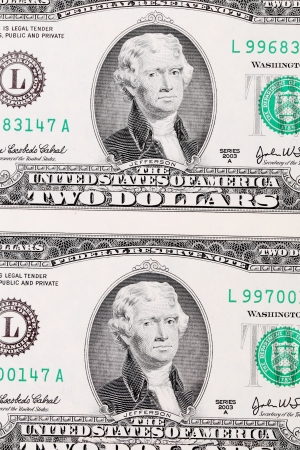 Background of two-dollar bills. Close up. Whole background. photo