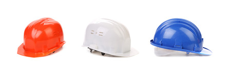 White red and blue hard hats. Isolated on a white background. photo