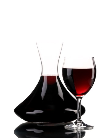Decanter and glass of wine. Isolated on a white background. photo