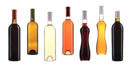 Set of seven bottles with wine. Isolated on a white background photo