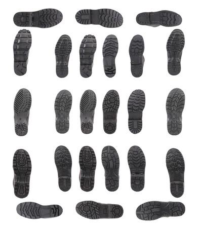Verschiedene schwarzen Schuhsohlen. Isoliert auf einem weißen Hintergrund.