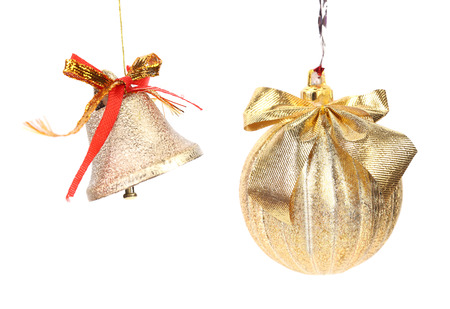 Golden christmas ball and jingle bell. Isolated on a white background photo