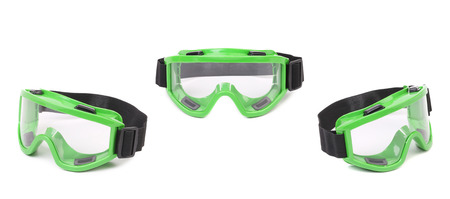 Set of green protective glasses. Isolated on a white background photo