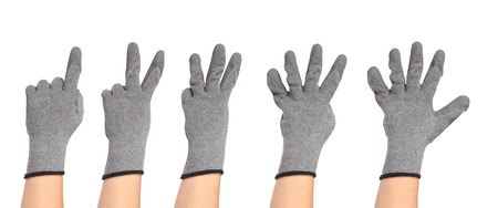 Hands in gloves show figures. Isolated on a white background photo