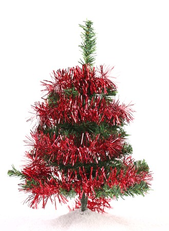 Christmas tree wrapped in tinsel. Isolated on a white background photo