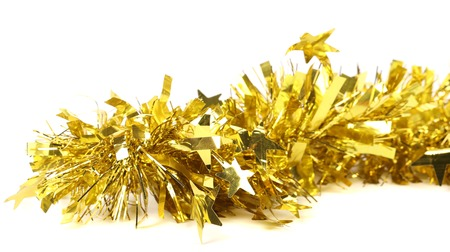 Close up of christmas yellow tinsel with stars. Isolated on a white background photo
