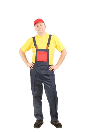 Man in working clothes with hands on hips. Close up