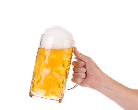 Hand holds mug of fresh beer with foam. Close up Stock Photo - 23802963