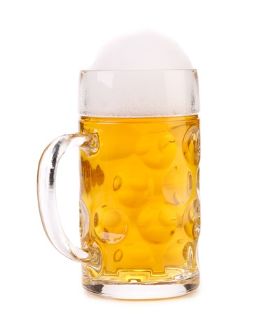 Tall big mug of beer with foam. Isolated on a white background. photo