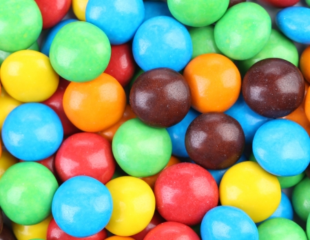 Backgroynd of chocolate balls in colorful glaze  Whole background photo