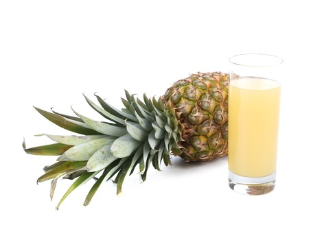 Glass of juice and pineapple. Isolated on a white background. photo