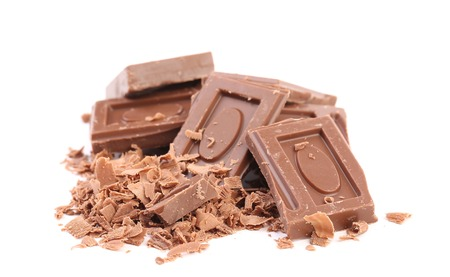 Chocolate bars and shaving. Isolated on a white background. Stock Photo