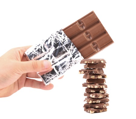 morsel: Bar of chocolate in foil and tasty morsel. Isolated on a white background. Stock Photo