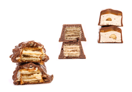Collage of three chocolate stacks. Isolated on a white background. photo