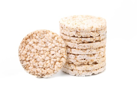 Stack of puffed rice snack. Isolated on a white background.
