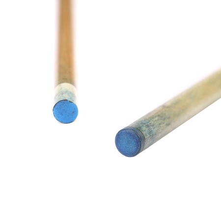 pool cues: Two pool cues. Blue end. Isolated on a white background.