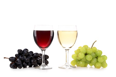 Wine and grapes composition. Isolated on a white background. photo