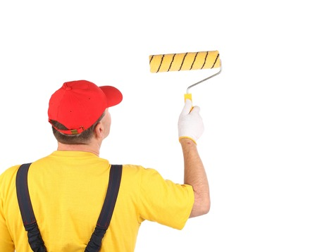 Worker working with roller. Isolated on a white background. photo