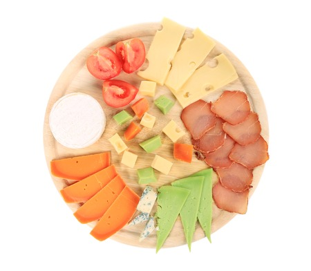Various types of cheese on wooden platter. Isolated on a white background. photo